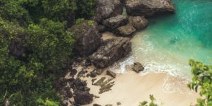 aerial-view-of-seashore-near-large-grey-rocks-853199