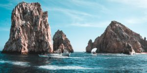 photo-of-boats-on-ocean-near-rock-formations-3271898
